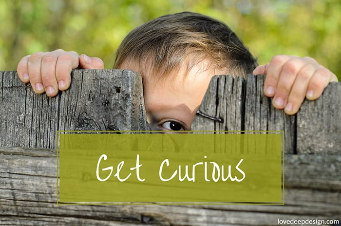 Kid peeking through fence - get curious