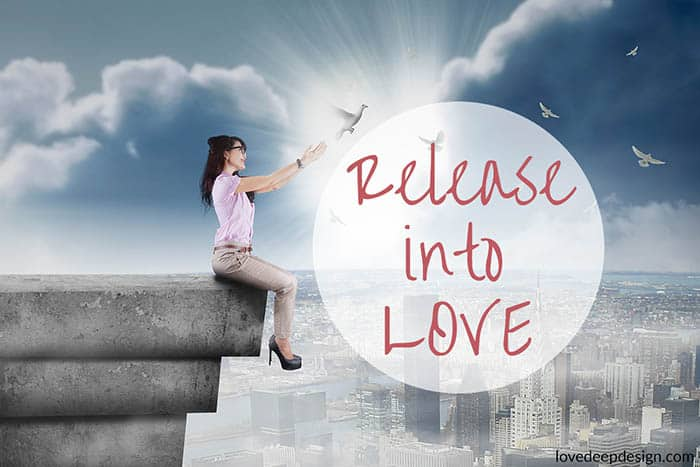 Woman on roof releasing dove w words Release into Love